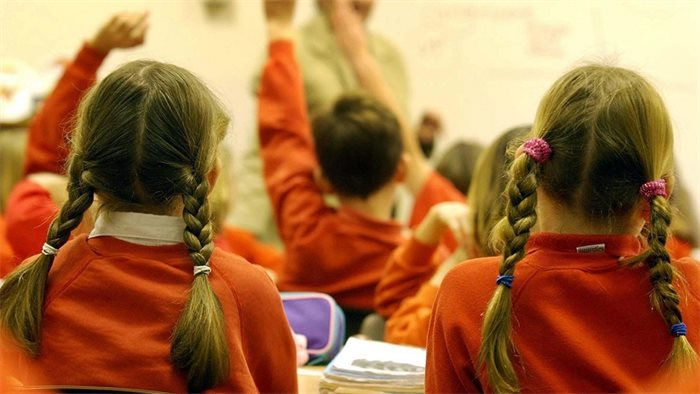Benefits of keeping schools open outweighs transmission risk says First Minister