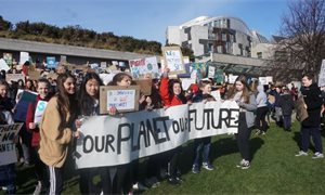 Hundreds gather outside Scottish Parliament for school climate strike