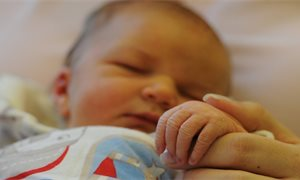 Low-income families receive new baby grant